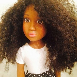 black creates black doll with hair to give