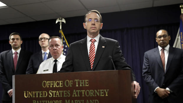 U.S. Attorney for the District of Maryland Rod J. Rosenstein speaks at a news conference in Baltimore, Wednesday, March 1, 2017, to announce that seven Baltimore police officers who worked on a firearms crime task force are facing charges of stealing money, property and narcotics from people over two years. Standing behind Rosenstein at left is Baltimore Police Department Commissioner Kevin Davis. (AP Photo/Patrick Semansky)